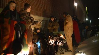 Shoppers in Sioux City wait outside in the cold before stores open on Black Friday.