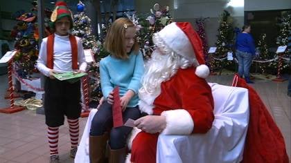 Girl meeting Saint Nick, at Breakfast with Santa event at the Ho-Chunk Building downtown.