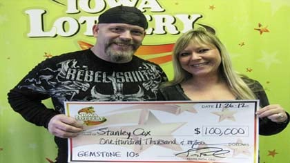 Stanley Cox wins $100,000 in an instant-scratch game.