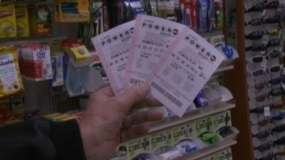 Winning ticket holders from Arizona and Missouri will split Wednesday night's record jackpot.