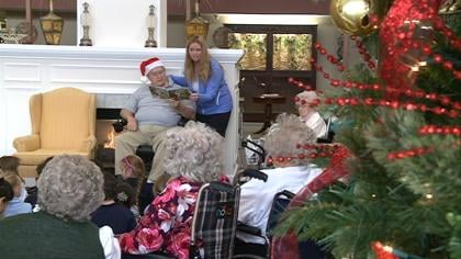 Students visiting residents at Northern Hills Retirement Community in Sioux City.