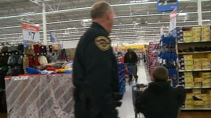 SC Police Chief Doug Young was one of 10 police officers to help children shop for Christmas presents.