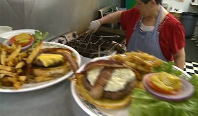 An order of burgers ready to be delivered to guests at Emma Rae's Cafe in Merrill, Iowa.