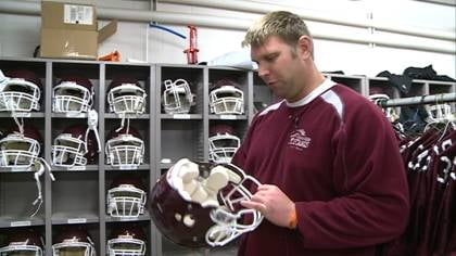 Morningside equipment manager Andy Poulosky prepares for Thursday's NAIA Championship Game.