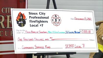 Check for $1,000 presented by Sioux City Fire Union to 3 local charities.