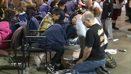 Hundreds of kids came out to get free shoes from Goodwill Industries annual shoes and mittens party.