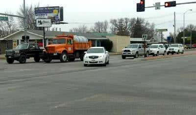 Drivers prepare for winter driving in Norfolk, Nebraska.