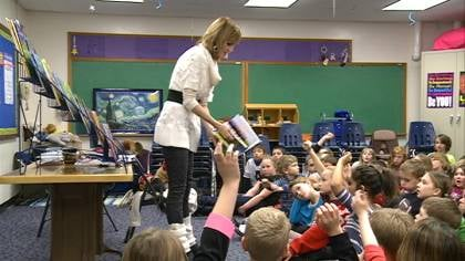Julia Cook shares a story with a group of children at Beadle Elementary in Yankton, S.D.