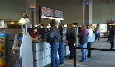 People lining up at Promenade Theatre to buy tickets on Christmas.