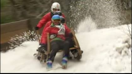 "Participants drive what are called ""horned sledges"" down an ice run."