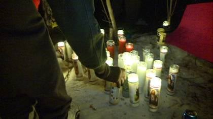 Friends and family members placed candles near the site of the car crash to remember the victims.