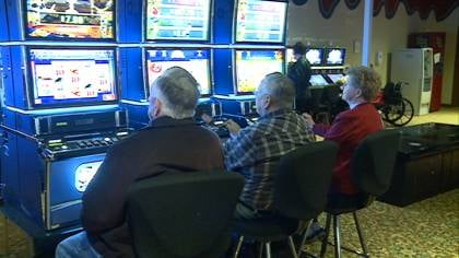 Customers say they're glad to be back playing slots at Blackbird Bend Casino near Onawa, Iowa.