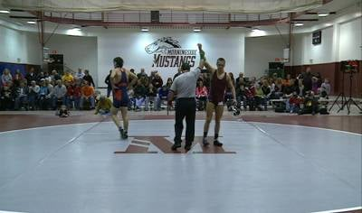 Morningside's Rulin Pederson wins his match in an 18-16 win over Midland on Wednesday.