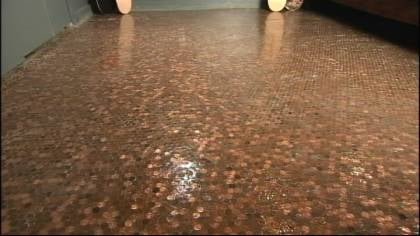 An estimated 59,670 pennies were used to cover the floor.