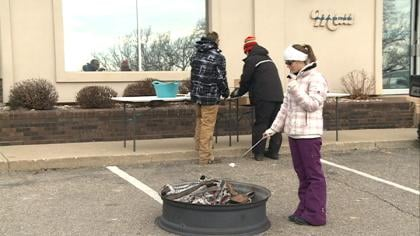 Mau Marine sits across from the Winter Games on West Lake Okoboji where visitors like those here, can come and make smores.