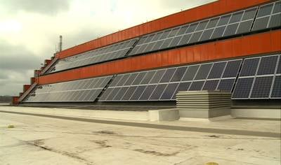 Each solar panel can produce up to 235 watts to provide electricity for the building.