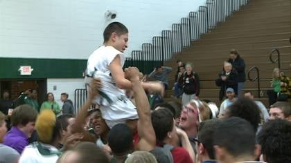 West fans celebrate after William Parker's three-pointer beat Dakota Valley, 82-81.