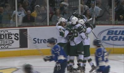 Conor McGlynn celebrates his first period goal with teammates.