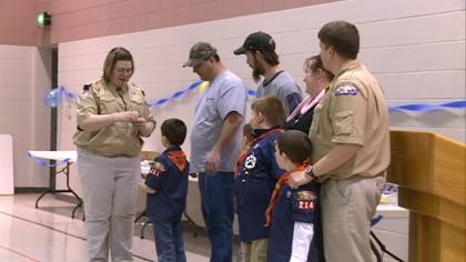Boy Scout Troop 214 celebrate the badges earned.