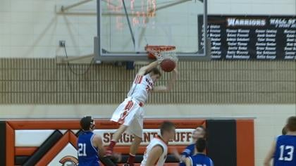 Nathan Glisar gets a dunk in Sgt. Bluff-Luton's 55-53 win over Woodbury Central on Tuesday.