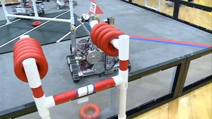 The competition was designed for the robots to take rings from one set of PVC pipe to another.