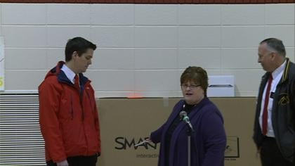 Mater Dei Immaculate Conception School receives a SMART board.