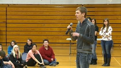 Brad Pickhinke explains to his classmates how they can help raise money to fight cancer.