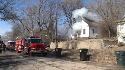 Sioux City Firefighters putting out house fire at 2619 10th Street.
