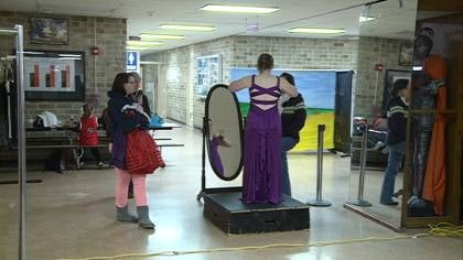 Girl in search of prom dress, trying on gown at East High School in Sioux City.