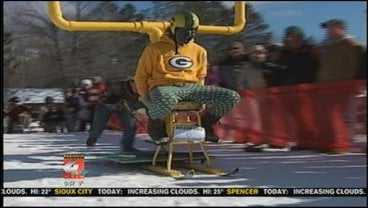Competitors strap skis to a stool and race to get down the slope.