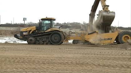 Crews are working to fill in an old lagoon in South Sioux City and convert it into additional campground.