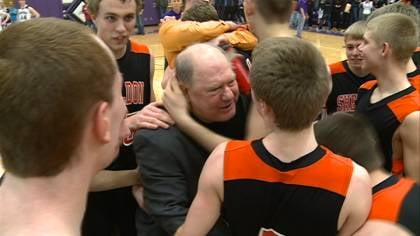 Sheldon Head Coach Claude Struve is mobbed by his team after the Orabs victory.