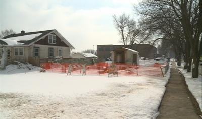 Homes prepped for removal to make way for new school on current Washington Elementary campus.