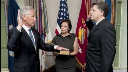 Defense Secretary by Michael L. Rhodes, the Defense Department's director of administration and management, as Hagel's wife, Lilibet, holds a Bible at the Pentagon.