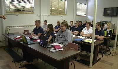 Bishop Heelan Catholic High School students learn about authority within the Catholic Church during Father Pat Behm's Peace and Justice class.