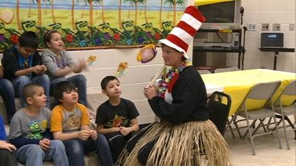 An Irving Elementary teacher dressed up in Dr. Seuss costume to celebrate Read Across America Day.