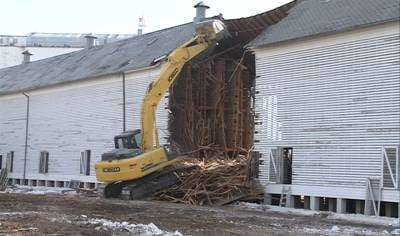 Bulldozer tearing down the last of the Jolly Time corn crib building.