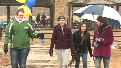 Students walking in the rain for cystic fibrosis.