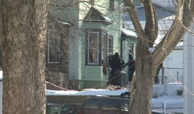 SWAT team going toward the house near the 100 block of Helen street in Sioux City.