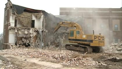 Bulldozer taking down Old Ida Grove High School.