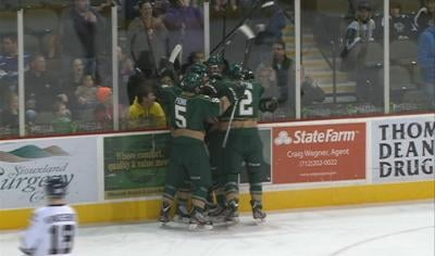 Cullen Munson celebrates his goal with teammates.