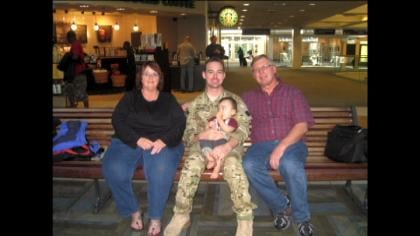 Army Staff Sergeant Steven Blass with family.