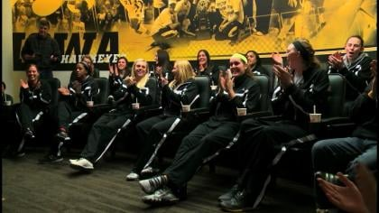 Iowa celebrates after leaning it'll host the first round of the NCAA Tournament.