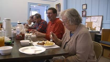 Mayor Dale Petersen shares a meal with volunteers and seniors at Sergeant Bluff, IA Senior Center.