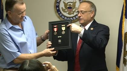 Rep. Steve King gave retired Vietnam veteran Robert Hutchinson four medals Tuesday.