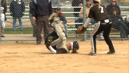 Morningside catcher Mackenzie Neely falls down after catching a pop up against Hastings.