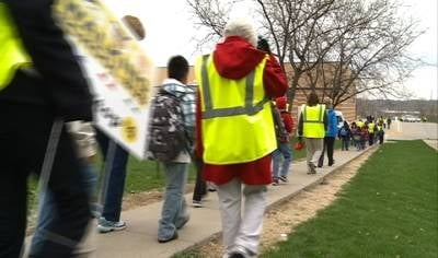 Fifty students from Irving Elementary, staff members, and volunteers make up this Walking School bus.