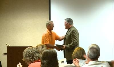 Dave Drew receives an award at the SOA banquet on Wednesday.