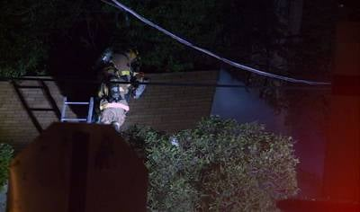 Crews ventilated the roof of a red-tagged home at 411 West Street to fight a fire.
