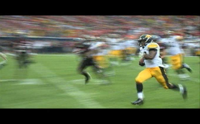 Iowa's Damon Bullock runs for the winning touchdown against Northern Illinois last season.